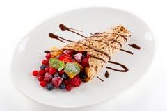 Fresh tasty homemade crepe pancake and fruits Royalty Free Stock Photos