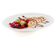 Fresh tasty homemade crepe pancake and fruits royalty free stock photo