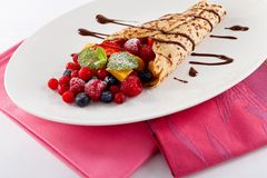 Fresh tasty homemade crepe pancake and fruits Royalty Free Stock Photos