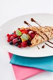 Fresh tasty homemade crepe pancake and fruits Stock Image