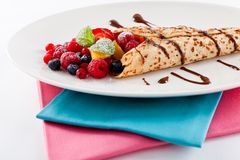 Fresh tasty homemade crepe pancake and fruits Stock Images