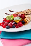 Fresh tasty homemade crepe pancake and fruits Royalty Free Stock Photography