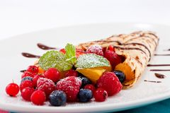 Fresh tasty homemade crepe pancake and fruits Stock Photo