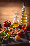 Fresh and tasty homemade pizza on wooden table with ingredients Royalty Free Stock Photos