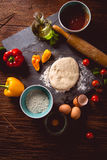 Fresh and tasty homemade pizza on wooden table with ingredients Royalty Free Stock Images