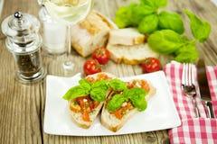 Fresh tasty italian bruschetta with tomato on table Royalty Free Stock Photography