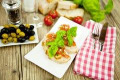 Fresh tasty italian bruschetta with tomato on table Stock Photo
