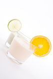 Fresh tasty lime and orange yoghurt shake cream isolated Stock Image