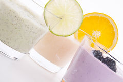 Fresh tasty lime and orange yoghurt shake cream isolated Stock Photos