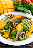 Fresh Tasty Mango, beef salad with vegetables and nuts. Stock Images