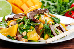 Fresh Tasty Mango, beef salad with vegetables and nuts. Royalty Free Stock Photography