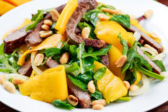 Fresh Tasty Mango, beef salad with vegetables and nuts. Stock Photos