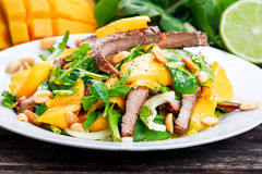 Fresh Tasty Mango, beef salad with vegetables and nuts. Royalty Free Stock Photo