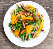 Fresh Tasty Mango, beef salad with vegetables and nuts. Royalty Free Stock Photos