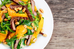 Fresh Tasty Mango, beef salad with vegetables and nuts. Stock Photo