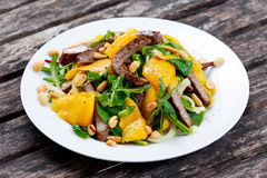 Fresh Tasty Mango, beef salad with vegetables and nuts. Royalty Free Stock Image