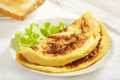 Fresh tasty omelet. On white plate royalty free stock photography