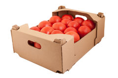 Fresh and tasty organic tomatoes in cardboard box, isolated on white Stock Images