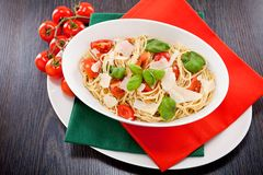Fresh tasty pasta spaghetti with tomatoes and basil Royalty Free Stock Images