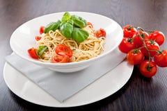 Fresh tasty pasta spaghetti with tomatoes and basil Stock Photo
