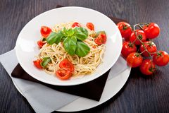Fresh tasty pasta spaghetti with tomatoes and basil Stock Images