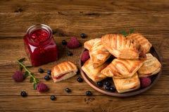 Fresh tasty pastries with raspberry jam royalty free stock photo