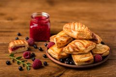 Fresh tasty pastries with raspberry jam royalty free stock photos