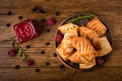 Fresh tasty pastries with raspberry jam stock images