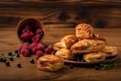Fresh tasty pastries with raspberry jam stock photography