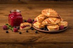 Fresh tasty pastries with raspberry jam stock photos