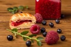 Fresh tasty pastries with raspberry jam royalty free stock photos