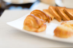 Fresh and tasty pastry on plate in cafe. Royalty Free Stock Photos