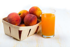 Fresh tasty peaches in wooden box Royalty Free Stock Photos