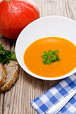 Fresh tasty pumpkin soup and bread Royalty Free Stock Photo