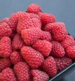Fresh tasty raspberries. Fresh raspberries in a black bowl, on a black background Stock Photography