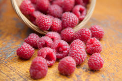 Fresh and tasty raspberries on a wooden table. Fresh and tasty looking raspberries on a wooden table Stock Images
