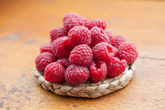 Fresh and tasty raspberries on a wooden table Royalty Free Stock Photo