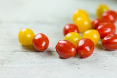Fresh tasty red and yellow tomatoes. On wooden background closeup Royalty Free Stock Image