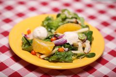 Fresh tasty salad in a plate on a tablecloth Stock Photo