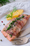 Salmon in the bacon coat Royalty Free Stock Images