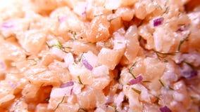 Fresh tasty Salmon Fish sliced with onion. 4K UHD. Native video stock footage