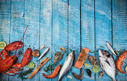 Fresh tasty seafood served on old wooden table. Stock Image
