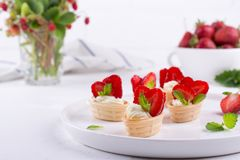 Fresh and tasty snack with cream cheese fruits and berries. Strawberries time royalty free stock images