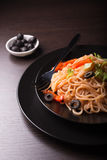 Fresh tasty spaghetti. Spaghetti with tomato sauce, olives and herbs Royalty Free Stock Images