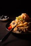 Fresh tasty spaghetti. Spaghetti with tomato sauce, olives and herbs Stock Image
