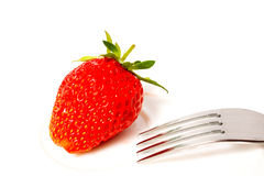 Fresh and tasty strawberries. On white plate Stock Photos