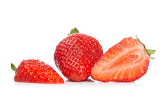 Fresh and tasty strawberries. A fresh and tasty strawberries reflected on white background Royalty Free Stock Photo