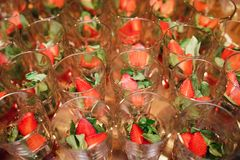 Fresh tasty strawberries in the glasses. Reception table. Fresh tasty strawberries in the glasses. Reception table Stock Photo