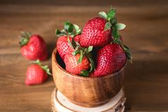 Fresh Tasty Strawberries in Wooden Bowl Wooden Rustic Background Close Up.  Royalty Free Stock Photography