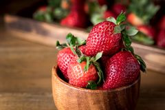 Fresh Tasty Strawberries in Wooden Bowl Wooden Rustic Background Close Up.  Royalty Free Stock Photos